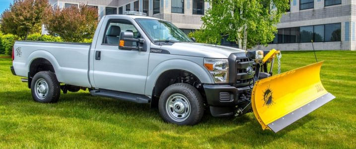 Upfitted gray pick up truck with yellow snow plow