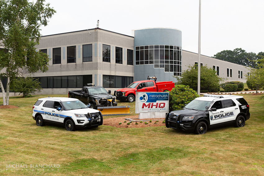 Upfitter law enforcement vehicles parked outside of MHQ building